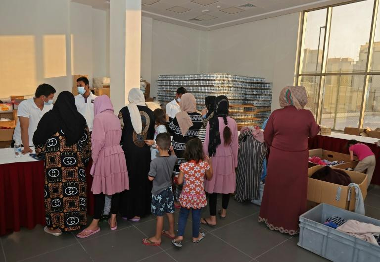 Tens of thousands of Afghan refugees have streamed into Qatar since the Taliban took power on August 15 (AFP/KARIM JAAFAR)