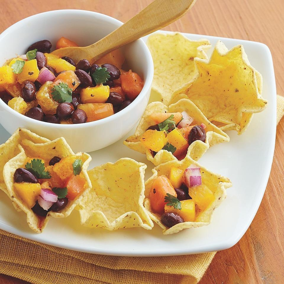 <p>This black bean salsa is sweetened with pieces of papaya, mango and orange, and served in individual scoop-shaped tortilla chips. It's quick to prepare and the perfect offering for your next gathering.</p>