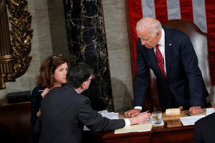 Vice President Joe Biden speaks with congressional staff during the counting of Electoral College votes on Capitol Hill in Washington, D.C., Jan. 6, 2017. (Aaron P. Bernstein/Reuters)