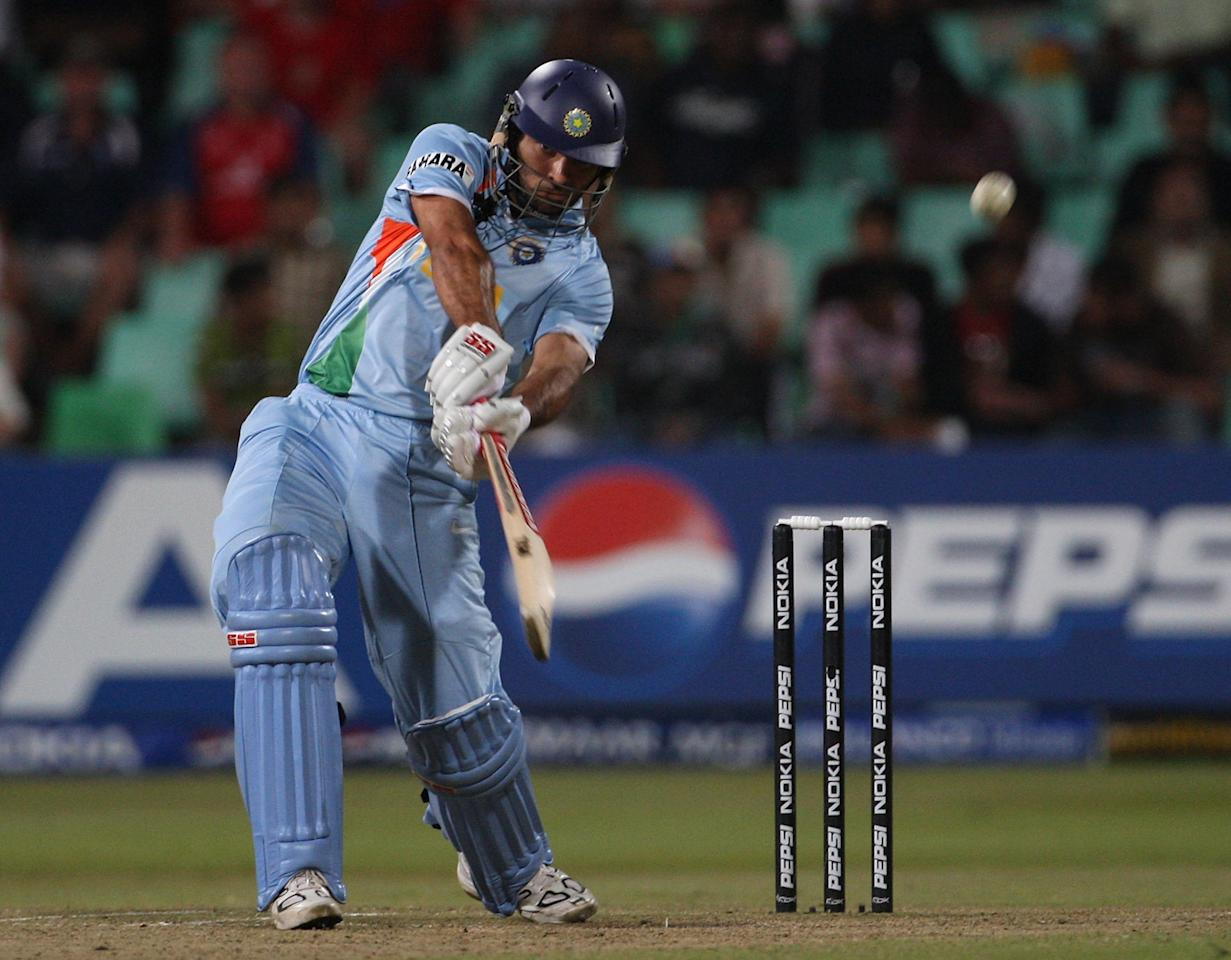 DURBAN, SOUTH AFRICA - SEPTEMBER 19:  Yuvraj Singh of India hits a six of Andrew Flintoff of England during the final over of the innings during the ICC Twenty20 Cricket World Championship Super Eights match between England and India at Kingsmead on September 19, 2007 in Durban, South Africa.  (Photo by Hamish Blair/Getty Images)
