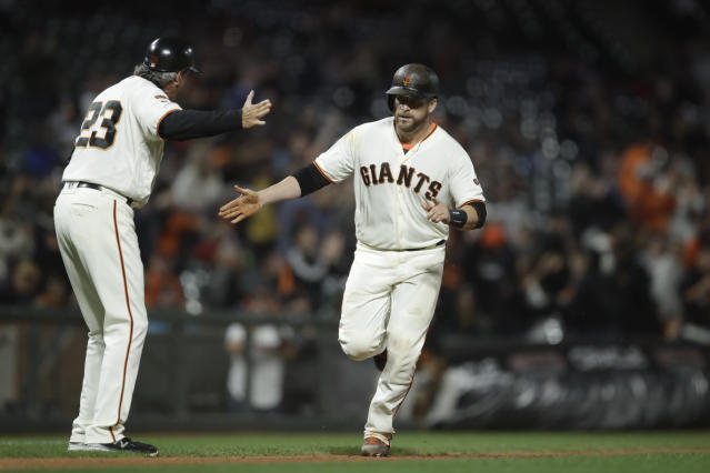 San Francisco Giants' Stephen Vogt, right, celebrates with third base coach Ron Wotus (23) after hitting a two-run home run off Pittsburgh Pirates' Mitch Keller during the fifth inning of a baseball game Tuesday, Sept. 10, 2019, in San Francisco. (AP Photo/Ben Margot)