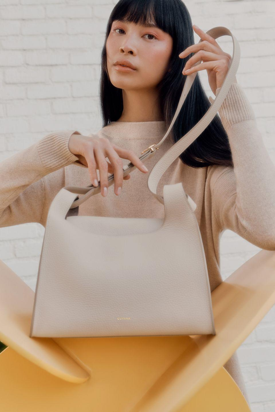 """<p><strong>Who:</strong> Cuyana<br></p><p><strong>What:</strong> Double Loop Bag and Mini Double Loop Bag</p><p><strong>Where:</strong> Online at cuyana.com</p><p><strong>Why: </strong>San Francisco based brand Cuyana has been devoted to high quality and sustainable leather goods since its inception ten years ago, and the latest offering is an expansion on their best-selling Oversized Double Loop Bag. The Crossbody allows hands-free, travel-friendly carrying of just the essentials. Don't miss the opportunity to sign up for the Mini Double Loop, a smaller version, which is available for pre-order now before its launch in May.</p><p><a class=""""link rapid-noclick-resp"""" href=""""https://go.redirectingat.com?id=74968X1596630&url=https%3A%2F%2Fwww.cuyana.com%2Fstories%2Fdouble-loop-bag.html&sref=https%3A%2F%2Fwww.elle.com%2Ffashion%2Fshopping%2Fg35685914%2Fmarch-2021-fashion-collaborations-launches%2F"""" rel=""""nofollow noopener"""" target=""""_blank"""" data-ylk=""""slk:SHOP NOW"""">SHOP NOW</a></p>"""