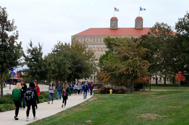 PHOTO: In this Oct. 24, 2019, file photo students walks in front of Fraser Hall on the University of Kansas campus in Lawrence, Kan. (Orlin Wagner/AP, FILE)