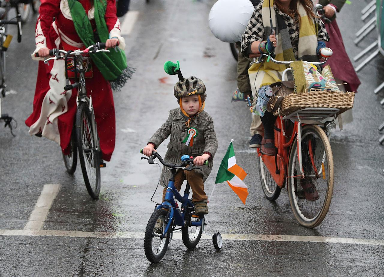 <p>A boy joins other participants in the St. Patrick's Day parade on the streets of Dublin, Friday, March 17, 2017. (Brian Lawless/PA via AP) </p>