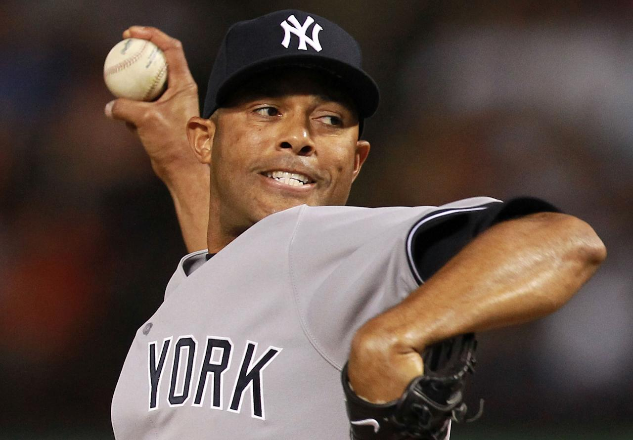 ARLINGTON, TX - APRIL 23:  Mariano Rivera #42 of the New York Yankees throws against the Texas Rangers at Rangers Ballpark in Arlington on April 23, 2012 in Arlington, Texas.  (Photo by Ronald Martinez/Getty Images)