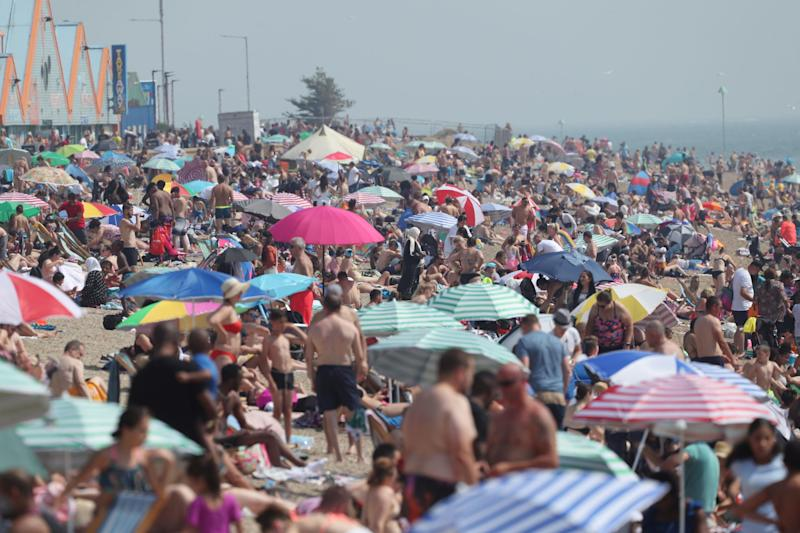 Crowds on Southend beach in Essex (PA)