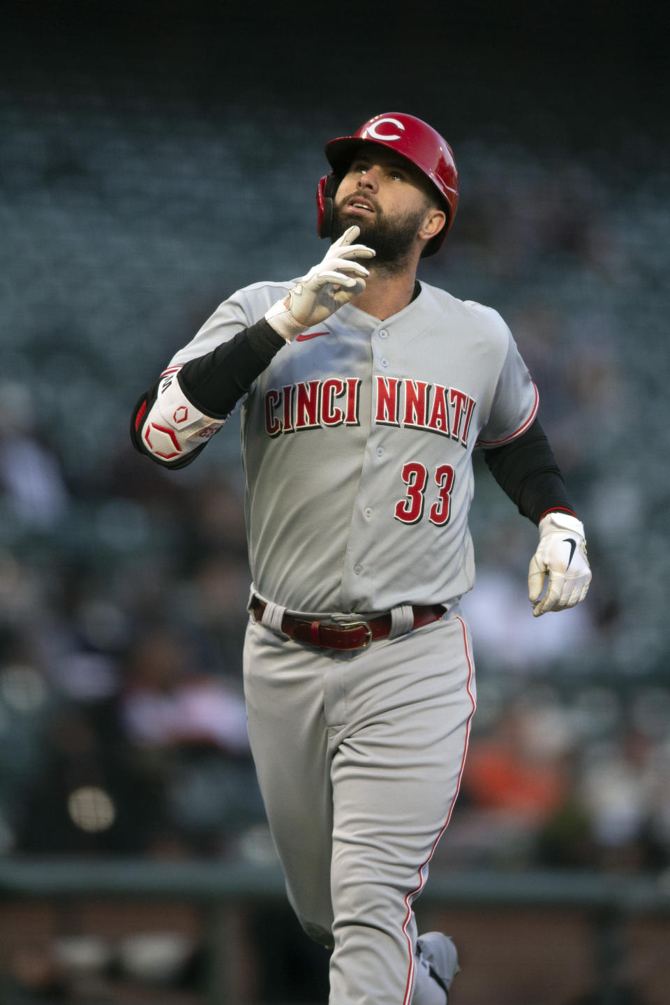 Cincinnati Reds' Jesse Winker points skyward as he runs out his two-run home run against the San Francisco Giants during the third inning of a baseball game, Monday, April 12, 2021, in San Francisco, Calif. (AP Photo/D. Ross Cameron)