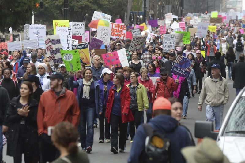 "Crowds march up Church Street towards Romare Bearden Park during Saturday's Women's March on Charlotte, which drew at least 10,000 people according to CMPD. The mile-long march was scheduled to coincide with a national demonstration Saturday, Jan. 21, 2017, in Washington, D.C., the day after Donald Trump's inauguration as president. The march started at First Ward Park, traveled down Tryon Street to 4th St. to Church St. and ended at Romare Bearden Park. ""The Women's March on Charlotte is a first step in uniting our communities and in empowering grassroots change,"" march organizers say on the march's website. ""We will work peacefully to send a bold message to our elected leaders that women's rights are human rights."" (Diedra Laird/The Charlotte Observer via AP)"