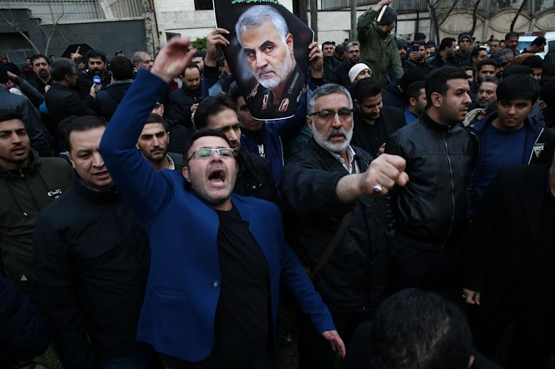 Iranian demonstrators react during a protest against the assassination of the Iranian Major-General Qassem Soleimani, head of the elite Quds Force, and Iraqi militia commander Abu Mahdi al-Muhandis, who were killed in an air strike at Baghdad airport, in front of United Nation office in Tehran, Iran January 3, 2020. Nazanin Tabatabaee/WANA (West Asia News Agency) via REUTERS ATTENTION EDITORS - THIS IMAGE HAS BEEN SUPPLIED BY A THIRD PARTY.