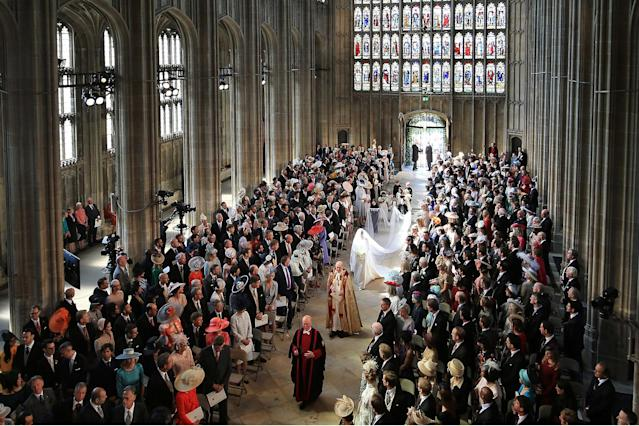 <p>Meghan Markle and her bridal party walk down the aisle of St. George's Chapel at Windsor Castle for the wedding. (Photo: Danny Lawson – WPA Pool/Getty Images) </p>