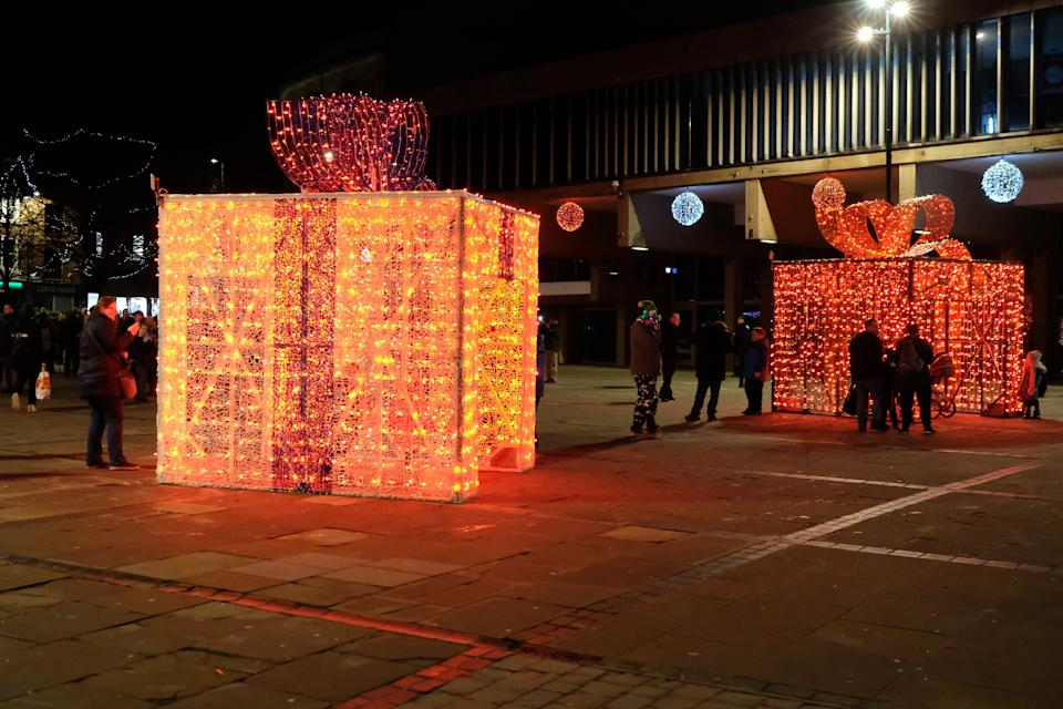 """Derby Christmas decorations, Derby City Centre, November 29 2019. A display of four illuminated Christmas presents has been ridiculed online and described as an embarrassing waste of money. Derby City Council spent £112,000 on the replacement for the ice skating rink it had in previous years. People on social media described the new feature as a """"disappointment"""", """"ridiculous"""", and """"dystopian"""". The council said it was """"disappointed"""" some people had chosen to judge the presents before they are fully working."""