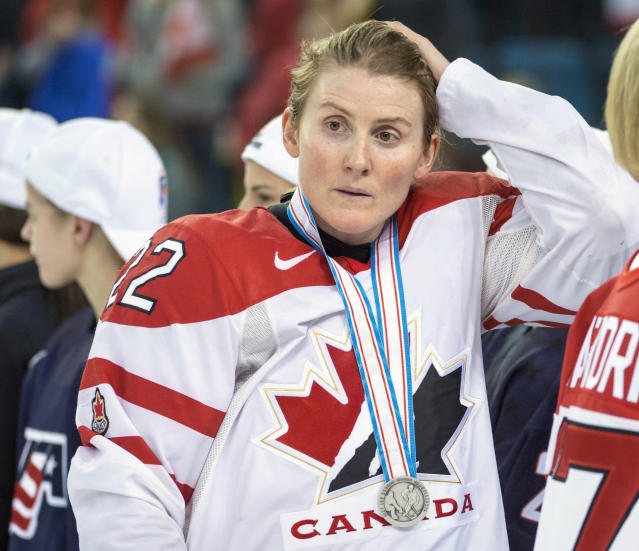 "FILE - In this April 4, 2016, file photo, Team Canada's Hayley Wickenheiser wears her silver medal after losing 1-0 to Team USA in the gold medal game at the women's world hockey championships in Kamloops, British Columbia. Regional Olympic officials are rallying around the IOC and have backed its stance on opening the Tokyo Games as scheduled. Their support comes one day after direct criticism from athletes amid the coronavirus outbreak. ""I think the IOC insisting this will move ahead, with such conviction, is insensitive and irresponsible given the state of humanity,"" said Wickenheiser, a four-time Olympic hockey gold medalist from Canada. (Ryan Remiorz/The Canadian Press via AP, File)"