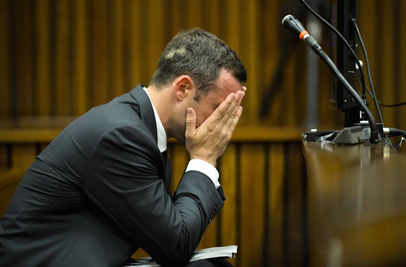 Oscar Pistorius, cradles his head in his hands in court on the fifth day of his trial at the high court in Pretoria, South Africa, Friday, March 7, 2014. Pistorius is charged with murder for the shooting death of his girlfriend, Reeva Steenkamp, on Valentines Day in 2013. (AP Photo/Theana Breugem, Pool)