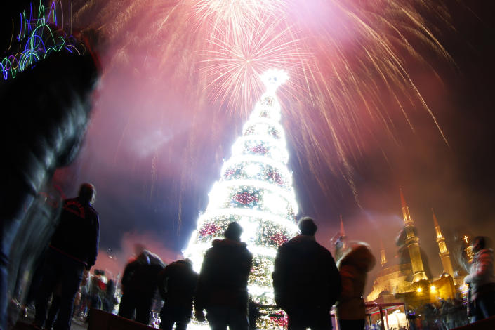 Fireworks explode over Martyrs Square . (Photo: Hassan Ammar/AP)