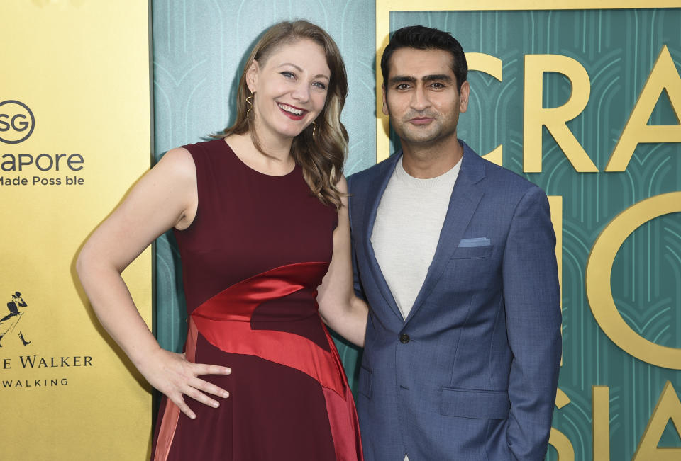 """Emily V. Gordon, left, and Kumail Nanjiani arrive at the premiere of """"Crazy Rich Asians"""" at the TCL Chinese Theatre on Tuesday, Aug. 7, 2018, in Los Angeles. (Photo by Richard Shotwell/Invision/AP)"""