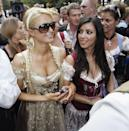 "<p>In the early Noughties, Kim had a job as a stylist to her childhood friend <a href=""https://www.elle.com/uk/life-and-culture/culture/a34127722/paris-hilton-apology/"" rel=""nofollow noopener"" target=""_blank"" data-ylk=""slk:Paris Hilton"" class=""link rapid-noclick-resp"">Paris Hilton</a>. Here she is with Hilton in 2006 at Munich's Oktoberfest where Hilton was promoting a drinks line. At the time, Hilton was at the height of her fame due to her appearance on The Simple Life with Nicole Richie - where Kim also made cameos.</p><p>In a <a href=""https://www.youtube.com/watch?time_continue=84&v=M84U7Yv6DAc&feature=emb_logo"" rel=""nofollow noopener"" target=""_blank"" data-ylk=""slk:2019 episode of"" class=""link rapid-noclick-resp"">2019 episode of </a><a href=""https://www.youtube.com/watch?time_continue=84&v=M84U7Yv6DAc&feature=emb_logo"" rel=""nofollow noopener"" target=""_blank"" data-ylk=""slk:Keeping Up With The Kardashians"" class=""link rapid-noclick-resp"">Keeping Up With The Kardashians</a>, Kim acknowledged that Hilton 'literally gave me a career'.</p>"