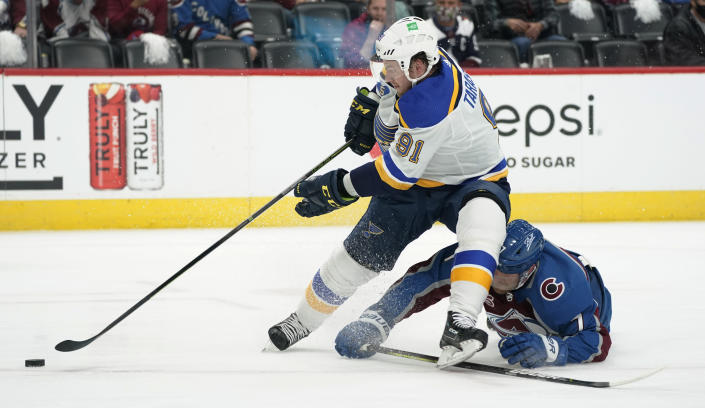 St. Louis Blues right wing Vladimir Tarasenko, front, drives to the net with the puck past Colorado Avalanche defenseman Devon Toews in the first period of Game 1 of an NHL hockey Stanley Cup first-round playoff series Monday, May 17, 2021, in Denver. (AP Photo/David Zalubowski)