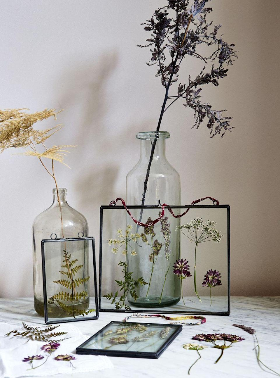 """<p>Wild flowers can easily be preserved and made into a beautiful glass framed display for a flower-loving friend. </p><p><strong>Get the tutorial at <a href=""""http://www.countryliving.co.uk/create/craft/how-to/a110/learn-the-art-of-flower-pressing/"""" rel=""""nofollow noopener"""" target=""""_blank"""" data-ylk=""""slk:Country Living UK"""" class=""""link rapid-noclick-resp""""><em>Country Living UK</em></a>.</strong> </p><p><strong><a class=""""link rapid-noclick-resp"""" href=""""https://go.redirectingat.com?id=74968X1596630&url=https%3A%2F%2Fwww.etsy.com%2Flisting%2F635208924%2Fbronze-picture-frames-hanging-on-walls&sref=https%3A%2F%2Fwww.countryliving.com%2Fdiy-crafts%2Ftips%2Fg645%2Fcrafty-christmas-presents-ideas%2F"""" rel=""""nofollow noopener"""" target=""""_blank"""" data-ylk=""""slk:SHOP SPECIMEN FRAME"""">SHOP SPECIMEN FRAME</a></strong></p>"""