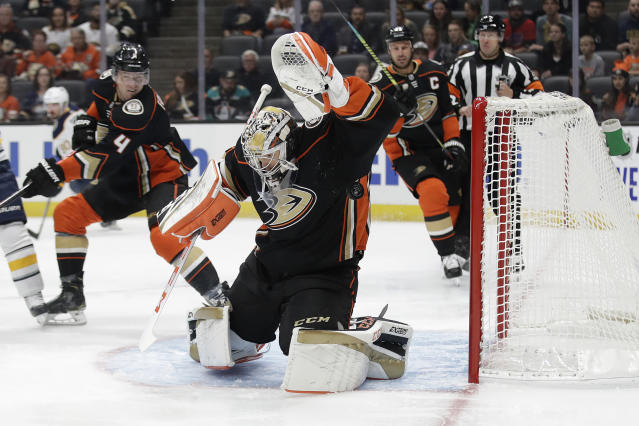 Anaheim Ducks goaltender John Gibson, center, stops a shot on goal by the Buffalo Sabres during the first period of an NHL hockey game Wednesday, Oct. 16, 2019, in Anaheim, Calif. (AP Photo/Marcio Jose Sanchez)