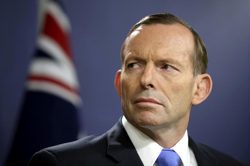 "FILE - In this Sept. 19, 2014, file photo, former Australian Prime Minister Tony Abbott speaks during a press conference, in Sydney. Abbott has claimed the ""top levels"" of the Malaysian government long suspected the vanishing of a plane almost six years ago was a mass murder-suicide by the pilot. (AP Photo/Rick Rycroft, File)"