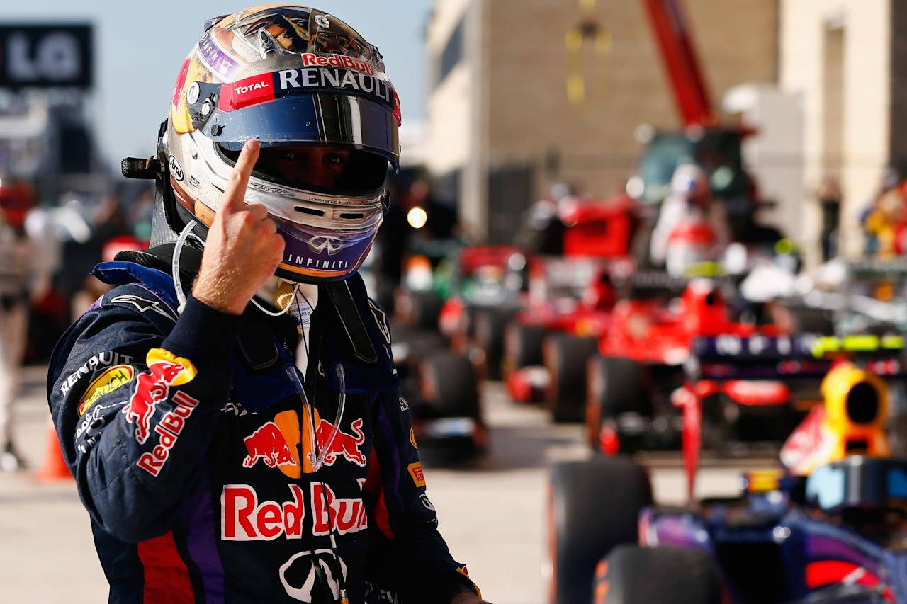 AUSTIN, TX - NOVEMBER 17: Sebastian Vettel of Germany and Infiniti Red Bull Racing celebrates after winning the United States Formula One Grand Prix at Circuit of The Americas on November 17, 2013 in Austin, United States. Vettel has won a record-setting eight consecutive races and clinched the 2013 F1 championship title. (Photo by Tom Pennington/Getty Images)