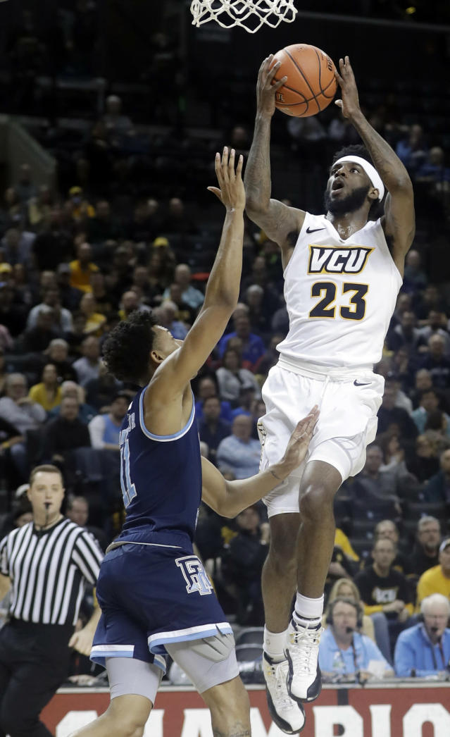 VCU's Issac Vann (23) shoots over Rhode Island's Jeff Dowtin (11) during the first half of an NCAA college basketball game in the Atlantic 10 men's tournament Friday, March 15, 2019, in New York. (AP Photo/Frank Franklin II)