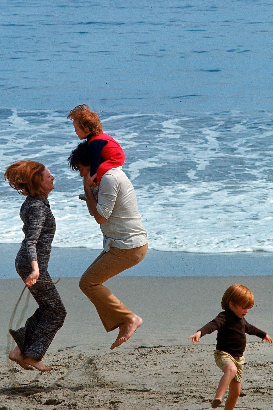 <p>Dame Maggie Smith jumps rope in the sand while spending the day with her family in 1971.</p>