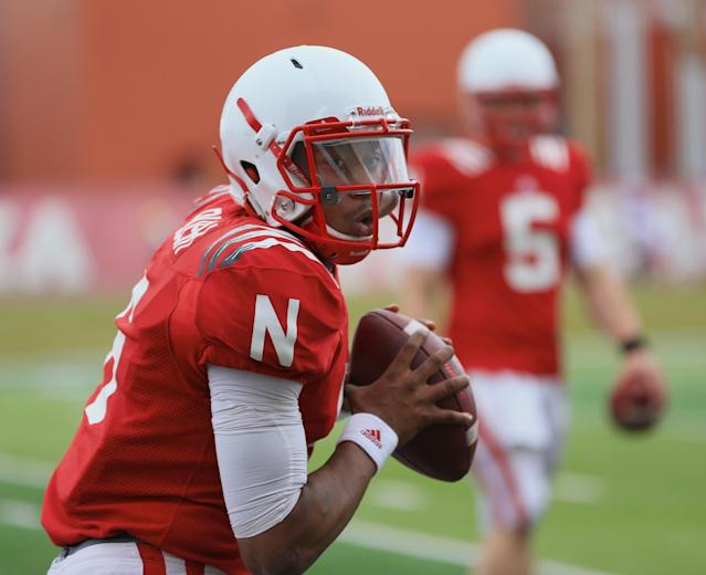 Nebraska quarterback AJ Bush participates in a drill during NCAA college football spring practice in Lincoln, Neb., Wednesday, March 18, 2015. Nebraska is two weeks into spring practice, and coach Mike Riley said the team is progressing about like he expected it would. He said the quarterbacks need to complete a higher percentage of passes and cut down on interceptions. (AP Photo/Nati Harnik)