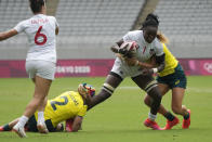 Cheta Emba of the United States, second right, comes under pressure from Australia's Charlotte Caslick, right, and Australia's Sharni Williams, in their women's rugby sevens match at the 2020 Summer Olympics, Friday, July 30, 2021 in Tokyo, Japan. (AP Photo/Shuji Kajiyama)