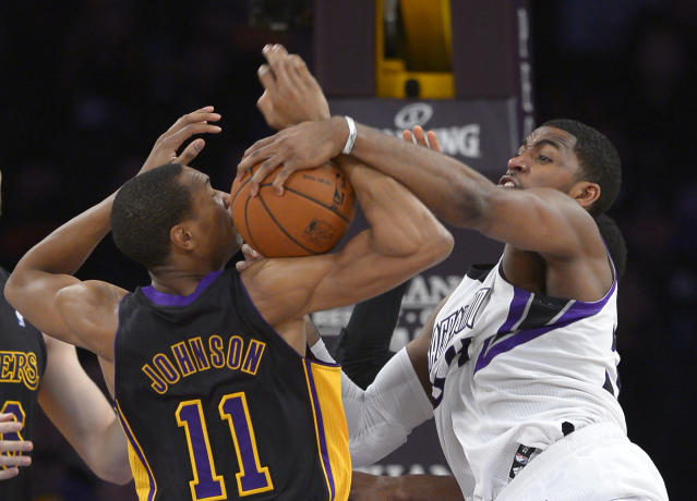 Los Angeles Lakers forward Wesley Johnson, left, and Sacramento Kings forward Jason Thompson battle for a rebound during the first half of an NBA basketball game, Friday, Feb. 28, 2014, in Los Angeles. (AP Photo/Mark J. Terrill)