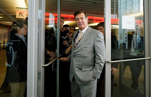 Paul Manafort, former campaign manager to Donald Trump, escapes a mob of reporters asking about the Republican National Convention Committee on Rules in Cleveland on July 14, 2016.