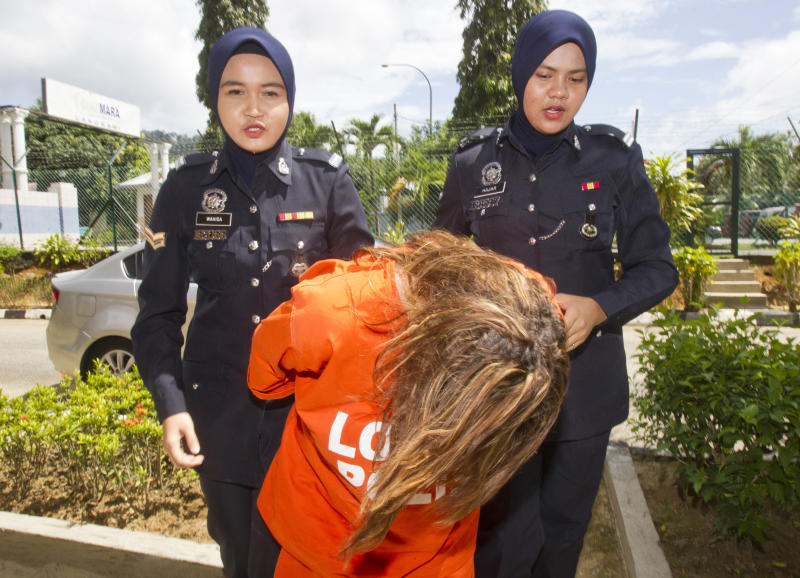 UK woman charged with murdering husband in Malaysia