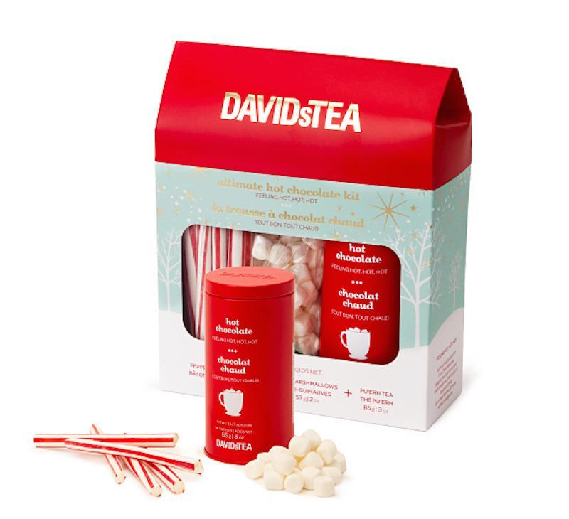 """<p>This twist on the classic wintertime drink features hot chocolate pu'erh tea, a variety of aged and fermented teas from China blended with cocoa nibs and chocolate chips. The kit comes complete with marshmallows and peppermint sticks for stirring. <b>Price: $25. <a href=""""https://www.davidstea.com/us_en/hot-chocolate-7"""" rel=""""nofollow noopener"""" target=""""_blank"""" data-ylk=""""slk:Buy the hot chocolate kit"""" class=""""link rapid-noclick-resp"""">Buy the hot chocolate kit</a>. </b><i>(Photo: David's Tea)</i></p>"""