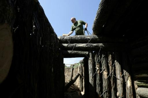 """Activists dig trenches and make other fortifications to build a new front line against """"Ukrainian tanks"""" not far from the pro-Russian rebel capital of Donetsk on May 5, 2018"""