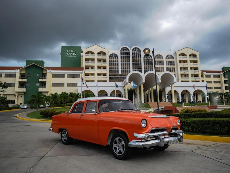 A vintage car passes in front of the Four Points by Sheraton hotel in Havana: (AFP)