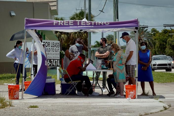 People wait to receive a COVID-19 test at a pop-up testing location on July 26, 2021 in Miami, Florida. (Joe Raedle/Getty Images)
