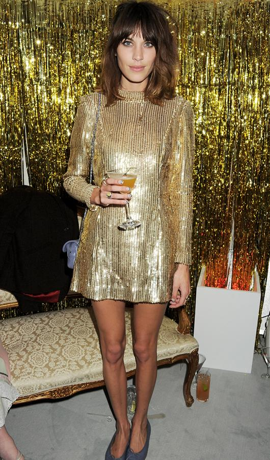 Celebrity fashion gold dresses: Alexa Chung was so prepared for the ELLE Style Awards that she matched the décor! Clad in a gold sequined long-sleeved frock she was the epitome of party cool.