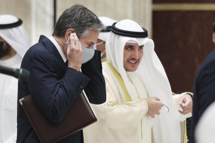 Kuwaiti Foreign Minister Sheikh Ahmad Nasser Al-Mohammad Al-Sabah and U.S. Secretary of State Antony Blinken depart at the end of a joint news conference at the Ministry of Foreign Affairs in Kuwait City, Kuwait, Thursday, July 29, 2021. (Jonathan Ernst/Pool via AP)