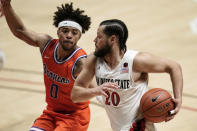 San Diego State guard Jordan Schakel (20) drives the ball against Boise State guard Marcus Shaver Jr. (0) during the first half of an NCAA college basketball game Saturday, Feb 27, 2021, in San Diego. (AP Photo/Gregory Bull)