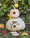 <p>Little hands will love helping create this sweet gourd cottage and keeping an eye out for the gnomes that are surely going to move in.</p><p><strong>To make:</strong> Cut a hole in the bottom of a medium-size blue Hubbard squash; scoop out the pulp and seeds. Cut out the door and circular door window. Etch lines in the door with a linoleum carving tool, and insert toothpicks (shortened if necessary) to create window muttons. Lightly draw flower design on either side of door with a pencil, and use linoleum carving tool to etch out. Insert the door into the opening and hold in place with toothpicks. Hot-glue mini glass balls into acorn caps to create lights; attach to pumpkin with hot-glue. Cut half to two-thirds off of a wood round; attach to pumpkin, above the door to create an awning.</p><p>Cut a hole in the bottom of a small brown or green acorn squash; scoop out the pulp and seeds. Cut a circular window, and insert toothpicks (shortened if necessary) to create window muntins. Lightly draw flower design around window with a pencil, and use linoleum carving tool to etch out. Stack pumpkins and add wood round steps and ginkgo leaves.</p>