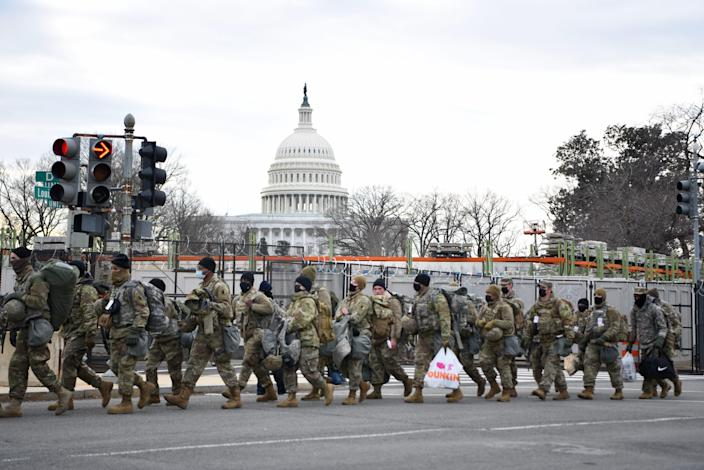 Members of the National Guard move along Louisiana Ave. NE in Washington, DC on Jan. 19, 2021.
