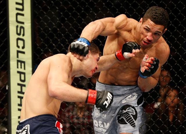 Kevin Lee, punching Al Iaquinta (L) in their lightweight fight at the UFC 169 event in 2014, will have a rematch with Iaquinta on Saturday. (Getty Images)