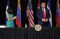 President Donald Trump and Rosa Maria Paya leave after a roundtable on Venezuela at Iglesia Doral Jesus Worship Center, Friday, July 10, 2020, in Doral, Fla. (AP Photo/Evan Vucci)