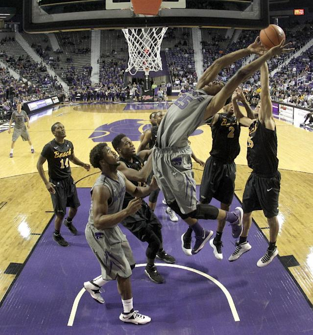 Kansas State's Wesley Iwundu (25) puts up a shot during the second half of an NCAA college basketball game against Long Beach State, Sunday, Nov. 17, 2013, in Manhattan, Kan. Kansas State won 71-58. (AP Photo/Charlie Riedel)