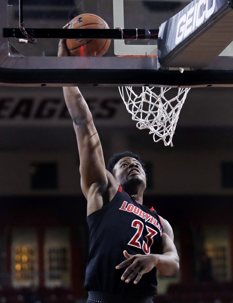 Louisville center Steven Enoch (23) lines up a dunk during the first half of an NCAA college basketball game against Boston College in Boston, Wednesday, Feb. 27, 2019. (AP Photo/Charles Krupa)