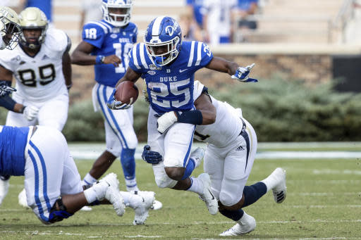 Duke's Deon Jackson (25) is tackled by Georgia Tech's Juanyeh Thomas (1) during an NCAA college football game in Durham, N.C., Saturday, Oct. 12, 2019. (AP Photo/Ben McKeown)