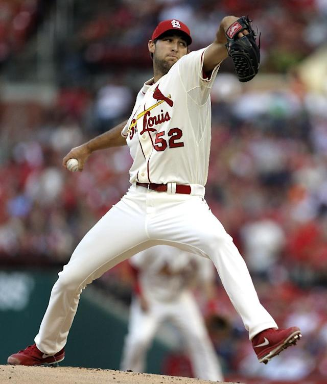 St. Louis Cardinals starting pitcher Michael Wacha throws against the Seattle Mariners during the first inning of a baseball game, Saturday, Sept. 14, 2013, in St. Louis. (AP Photo/Jeff Roberson)