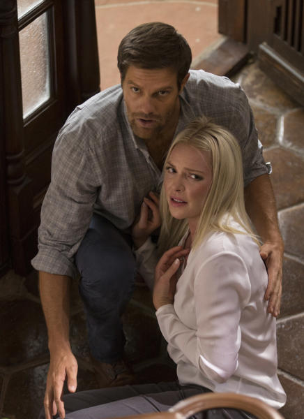 """This image released by Warner Bros. Pictures shows Geoff Stults, left, and Katherine Heigl in a scene from, """"Unforgettable."""" (Karen Ballard/Warner Bros. Pictures via AP)"""