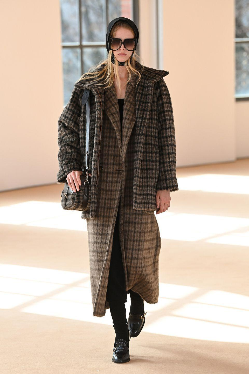 <p>English mainstays meet a chic Italiana woman for Max Mara's Fall collection. Think: tartans and cashmere, headscarves and Fair Isle knits. Who doesn't want to be her? The creator of the famed teddy coat (they're in here too, don't worry) is celebrating 70 years since Achille Maramotti founded the storied brand as a shopping destination for the wives of local notaries and doctors. Luckily, now the ladies who frequent Max Mara's boutiques are the professionals themselves—all the better for investing in all those camel coats. <em>-Kerry Pieri</em></p>