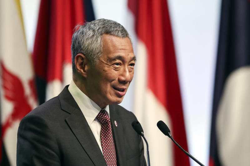 The Latest: Singapore PM says China-US rivalry 'awkward'